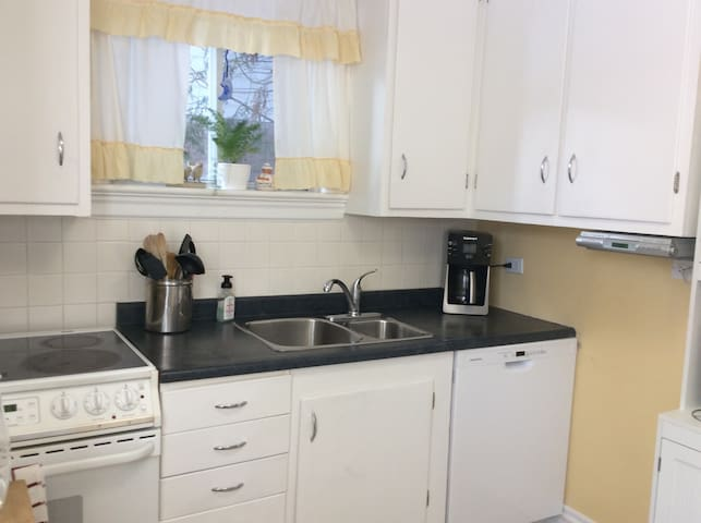 Kitchen with stove, dishwasher, microwave and all cookware and utensils and spices