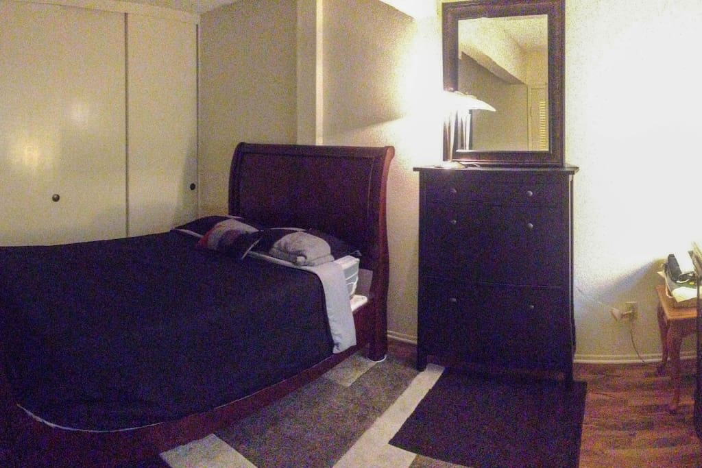 Comfortable Queen bed with closet, shoe cabinet & extra dresser space for use.