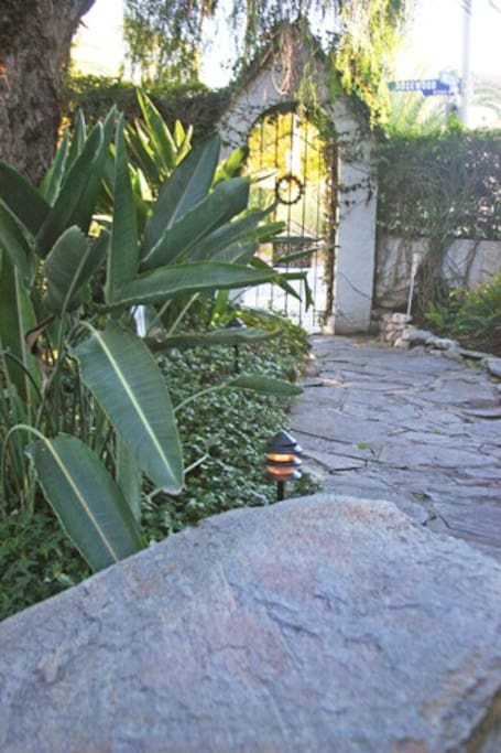 Stone walkway leading from gate
