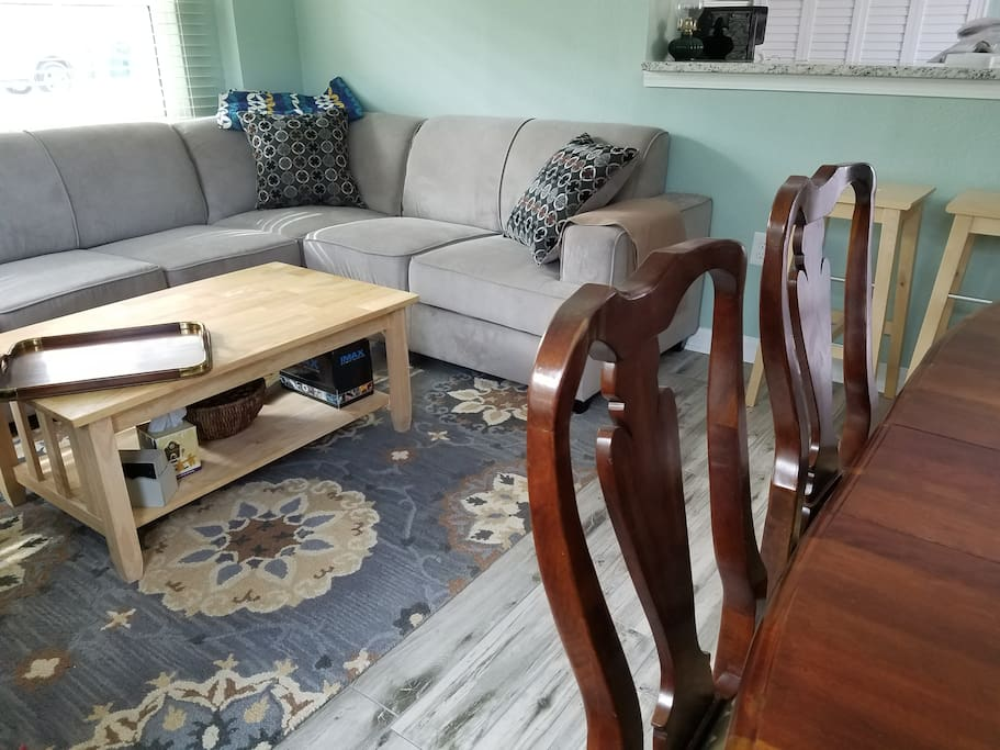 Queen sleeper sofa w/tempurpedic mattress, lift up table top, big basket of games and puzzles.