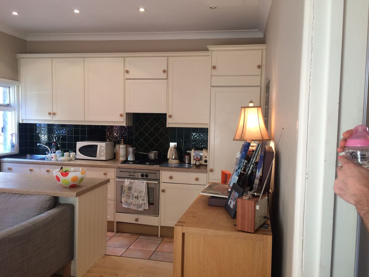 Kitchen with breakfast bar & dining table. Leads out to a patio & garden area.