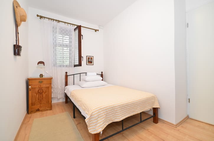 Third bedroom is decorated in a rustic style. Larger bed is suitable for one biger or two thin persons.