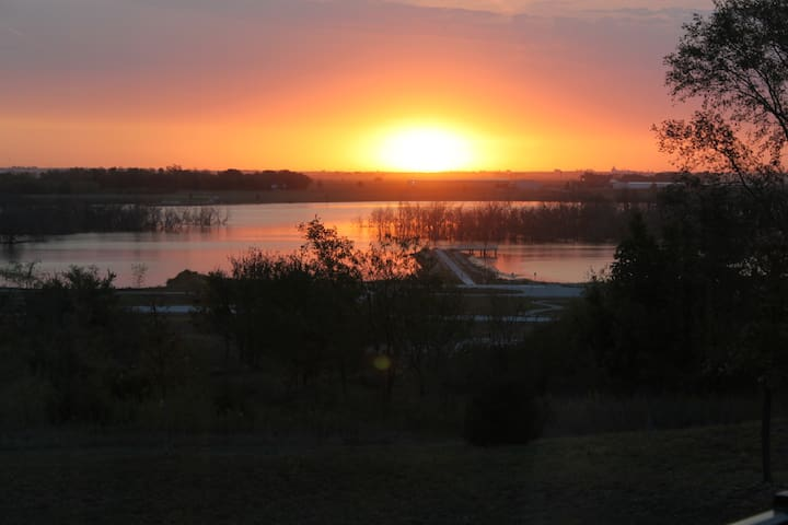 Beautiful sunrise over Lake Wanahoo from the master bedroom deck.