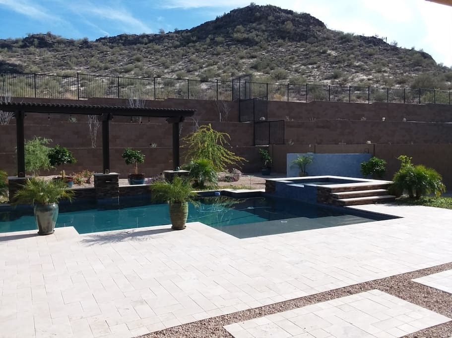 Backyard with relaxing pool and spa backing to Mountain & hiking trails.