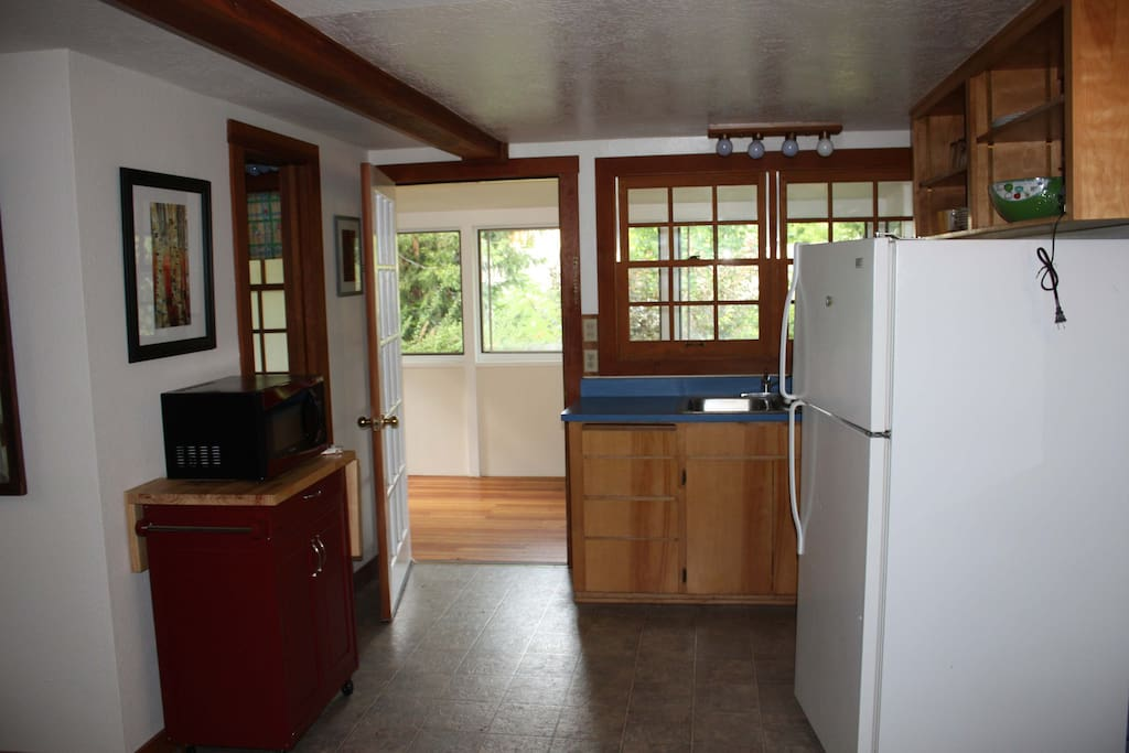 Beautiful kitchen opens up into the sunroom