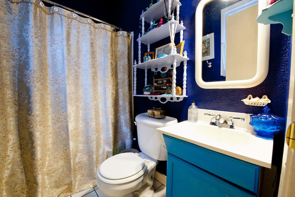 Soothing Dark Blue Bathroom - hair dryer, toiletries, and q-tips supplied.