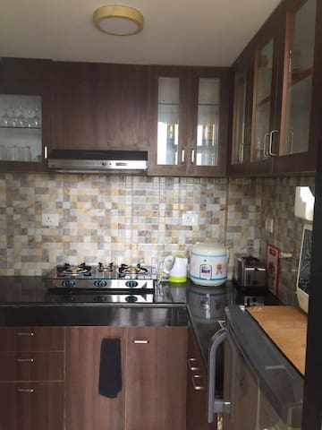 kitchen with all utensils, gas, freeze, washing machine