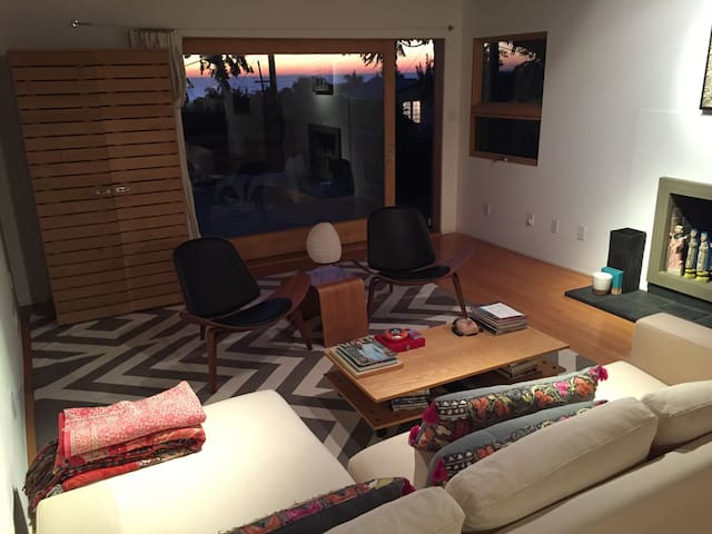 Living room with fireplace and large sliding door to deck