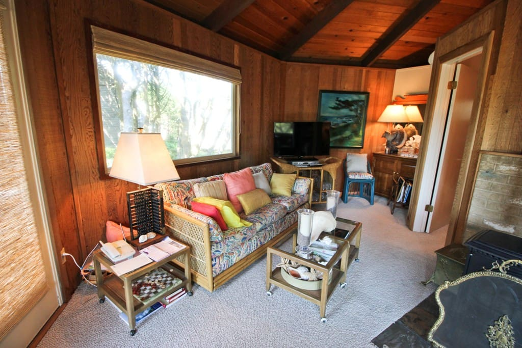 Upper level circular living/kitchen/dining area.  Flat screen cable TV/DVD player, glass front wood stove, two couches and a door to the upper deck