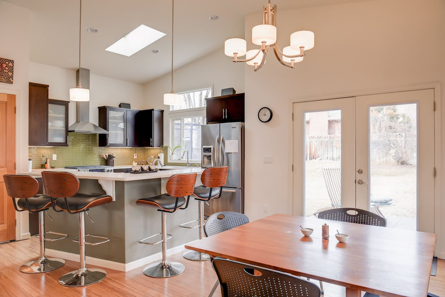 open kitchen with bar, custom redwood table extends to fit 10 people
