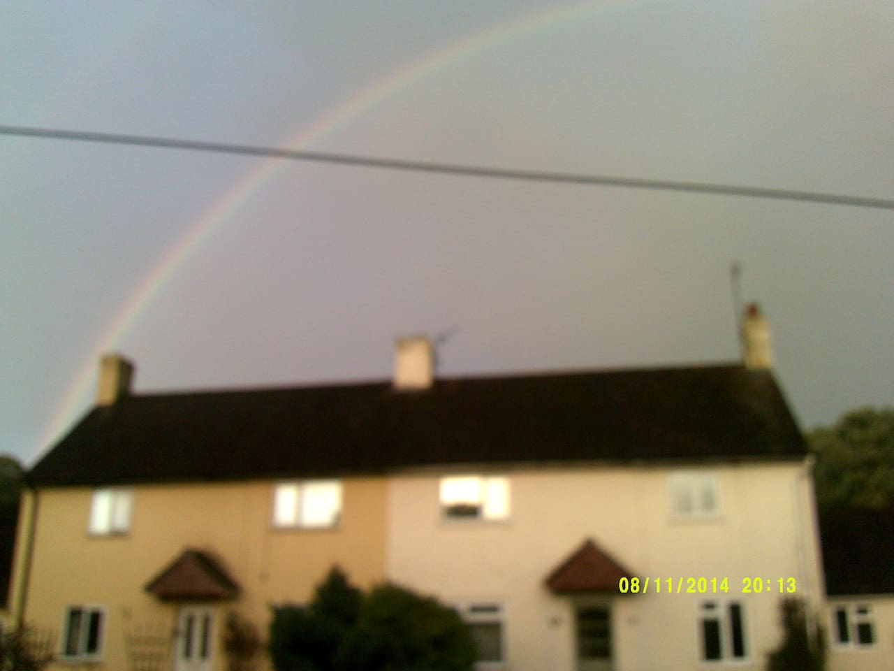 Rainbow over the hose on a summers evening after a storm
