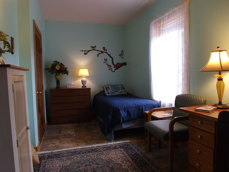 smaller bedroom with comfortable twin bed.