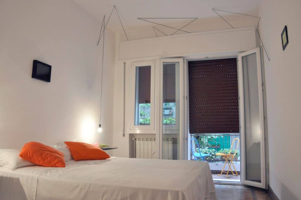 Double bed in room with balcony