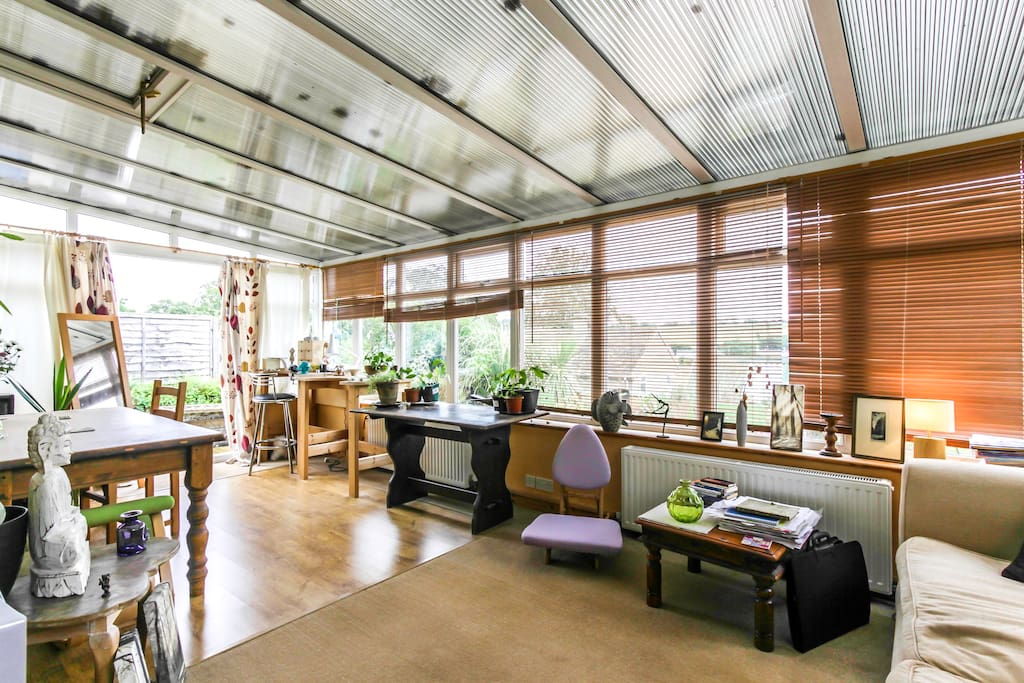 The conservatory is spacious and light, with lovely views.