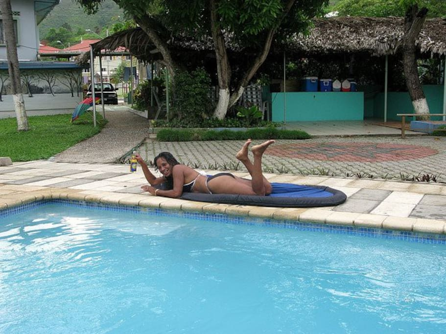 Enjoying a Carib poolside