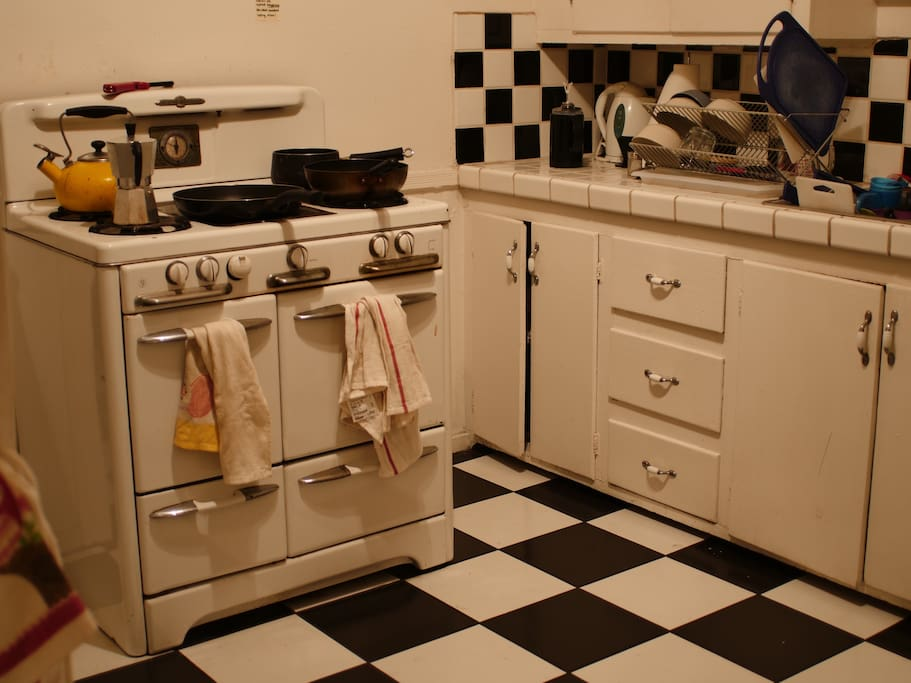 Kitchen with gas stove, oven, sink and refrigerator