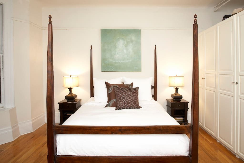 Four-post wooden bed.
