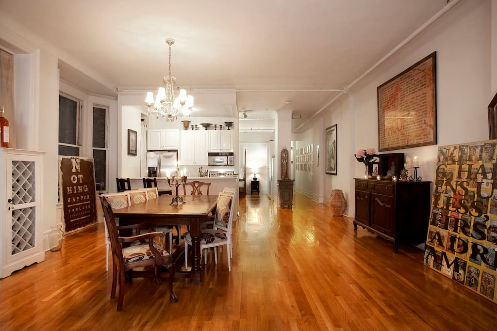 Dining space with views into Kitchen, Entrance, and Bedroom.