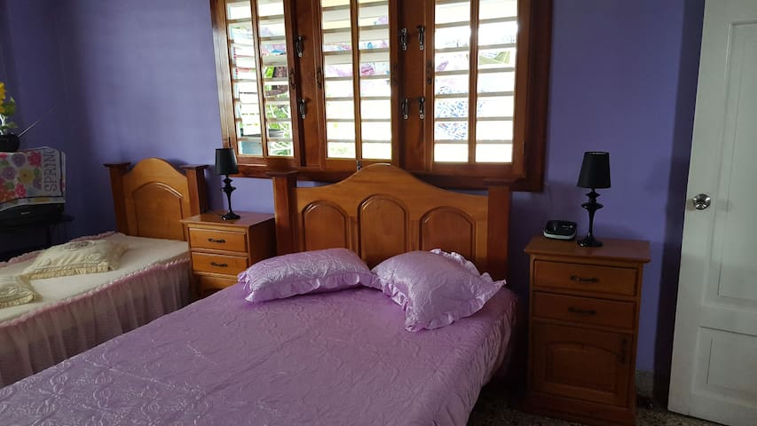 Enjoy your stay in the Purple Room of La Tropical