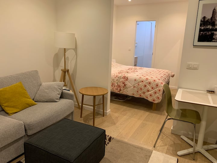 Double bed in renovated apartment