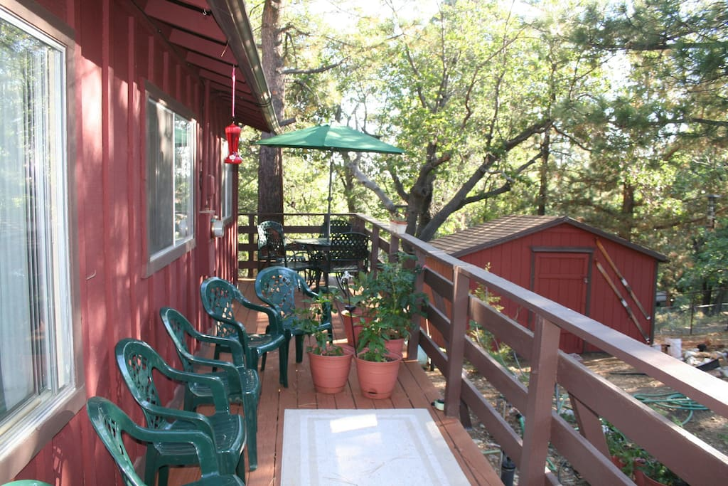 Deck with table, umbrella, chairs, barbeque