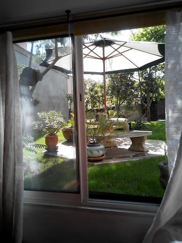 Logement sur jardin  ensoleillé