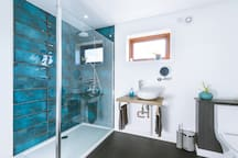 Both of our rooms have a luxurious shower room and access to an additional wetroom.