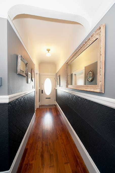 Shared entrance hallway with classic wainscoting
