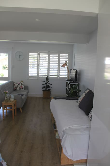Comfortable 3 seater couch close to television as well as Day Bed/Single bed always with fresh linen.