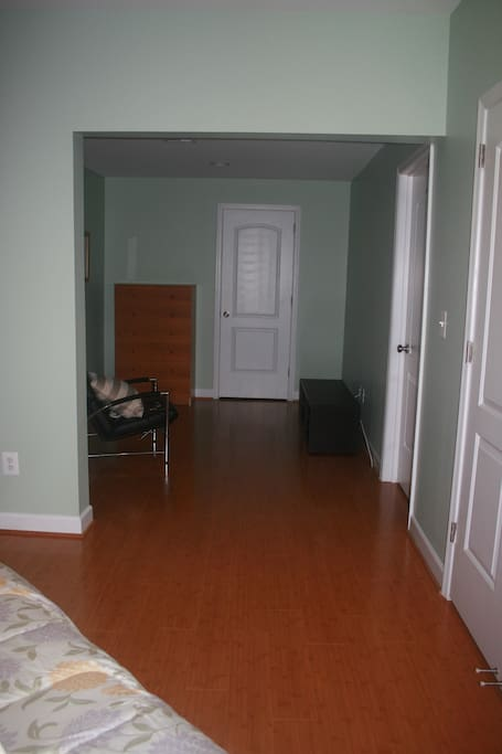Sitting area with cable TV next to the bedroom