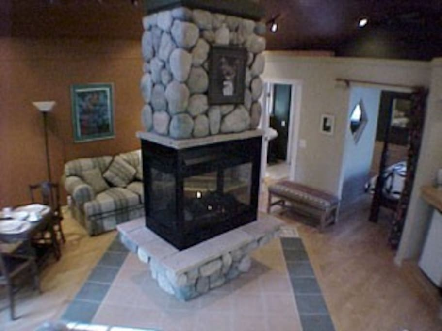 Stunning river rock gas fireplace for those cozy nights with a glass of wine.