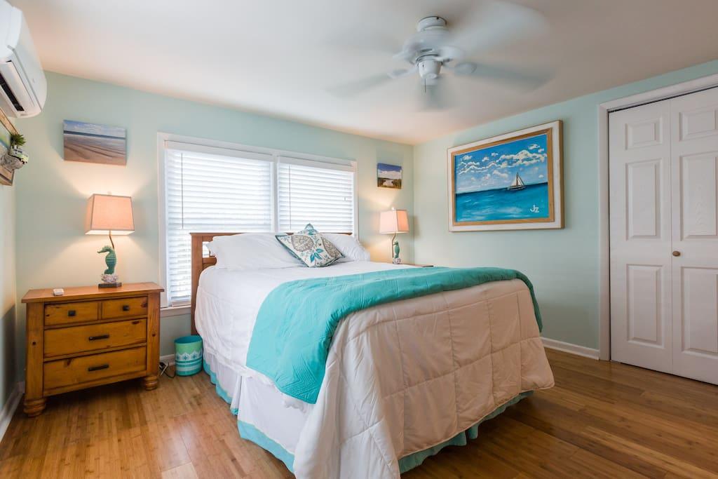 Deluxe Queen bed with luxury linens.
