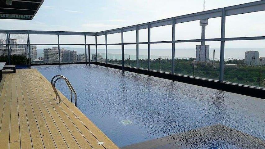 Tree-Tops Condo with Partial Sea View 13th Floor