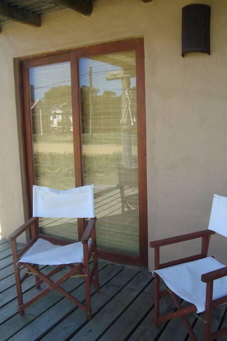 deck con sillas reposeras,hamacas...