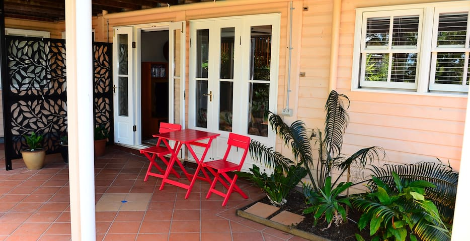 Outdoor areas to relax, eat and swim
