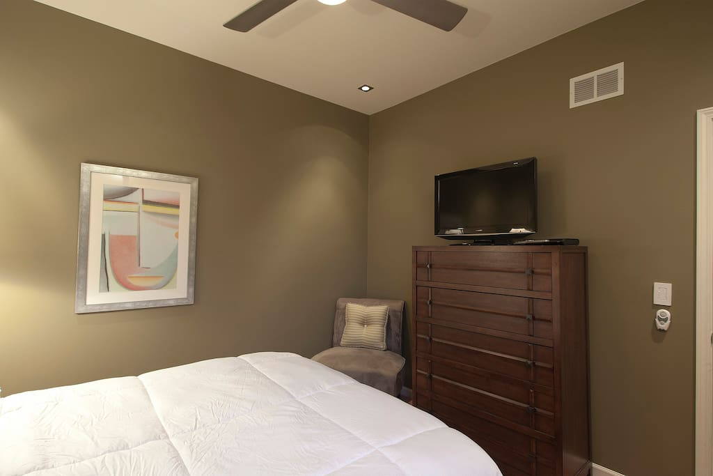 Queen bedroom with pillow top mattress, blu-ray player, ceiling fan and dimmeable ceiling lighting