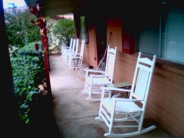 Front porch with six rocking chairs