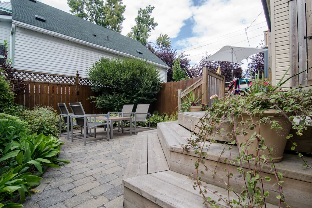 Backyard with sitting area and garden. Parking space in driveway available.