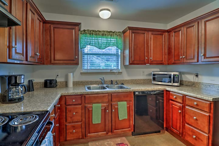 Wraparound counters and chic cabinets detail the fully equipped kithcen.