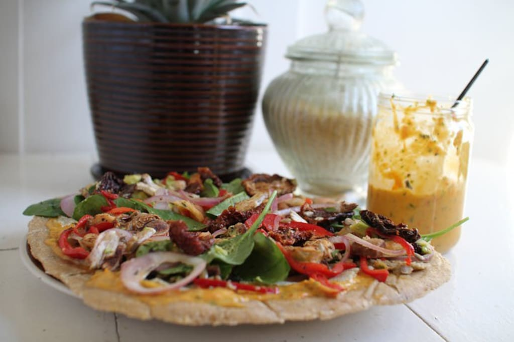 Learn how to make your favorite dishes healthy without sacrifices taste! Here is the raw vegan pizza! A top favorite.