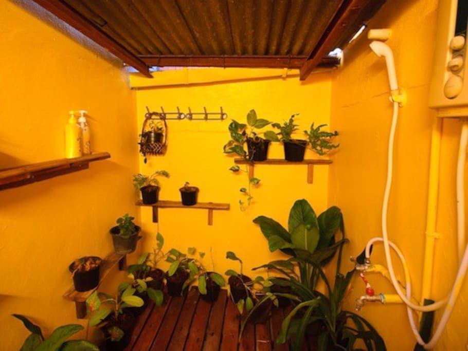 Shared bathroom with hot shower.