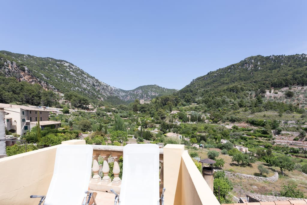Roof terrace from the upper floor boasts gorgeous views and loungers to soak up the summer rays.