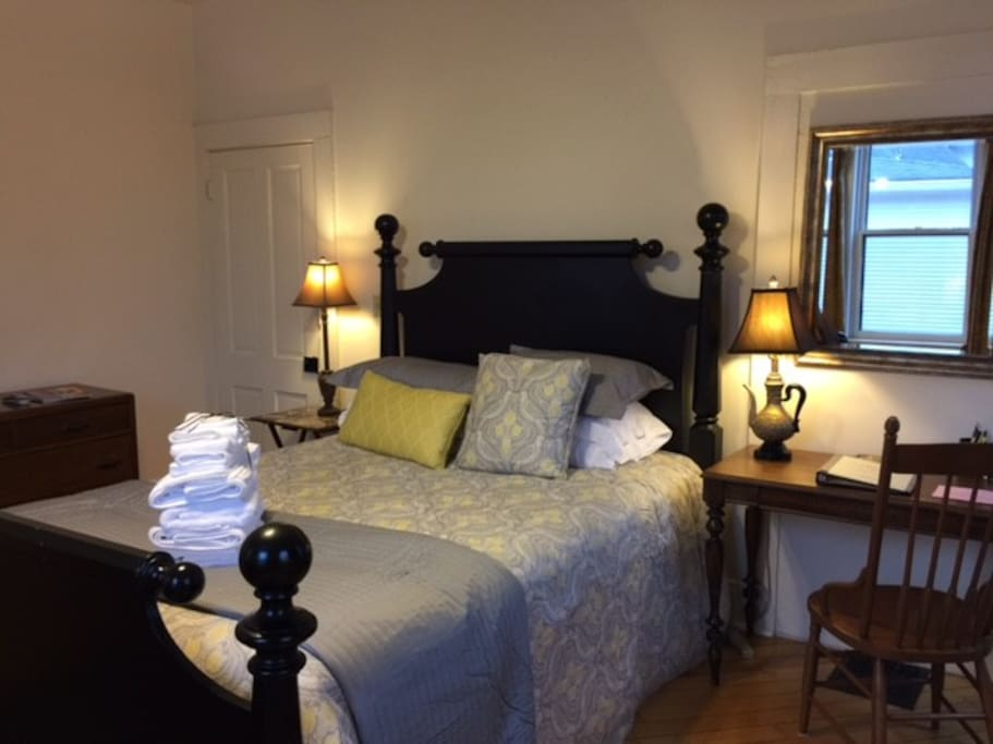 Bedroom includes dresser, closet, sofa, writing desk, and reading chair. It is also one of our few suites with a smart TV!