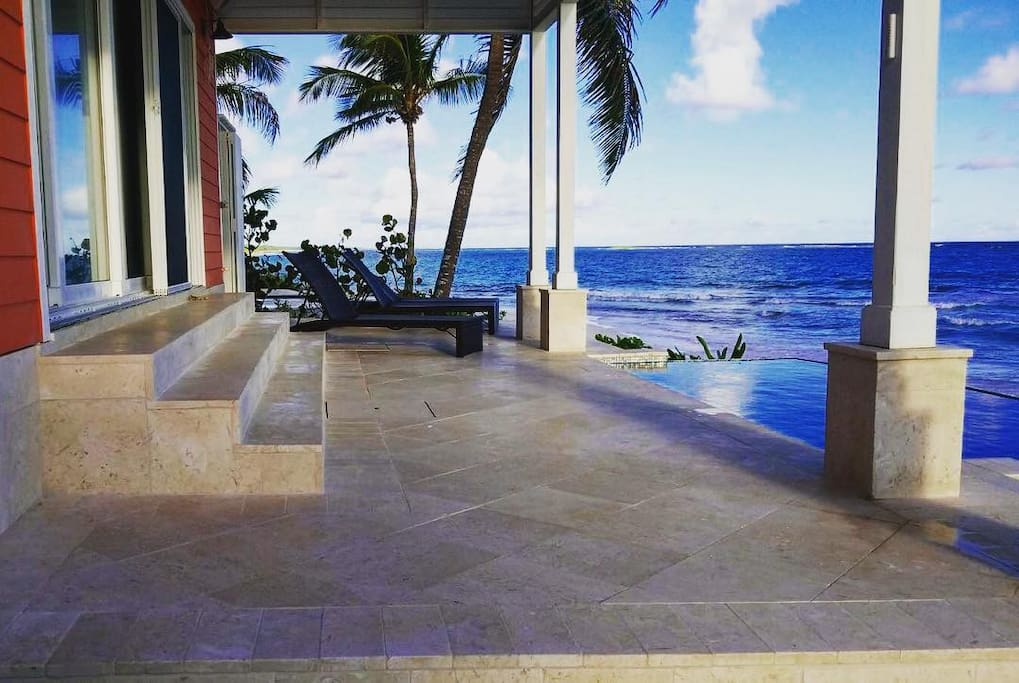 Private beach front deck with infinity edge pool