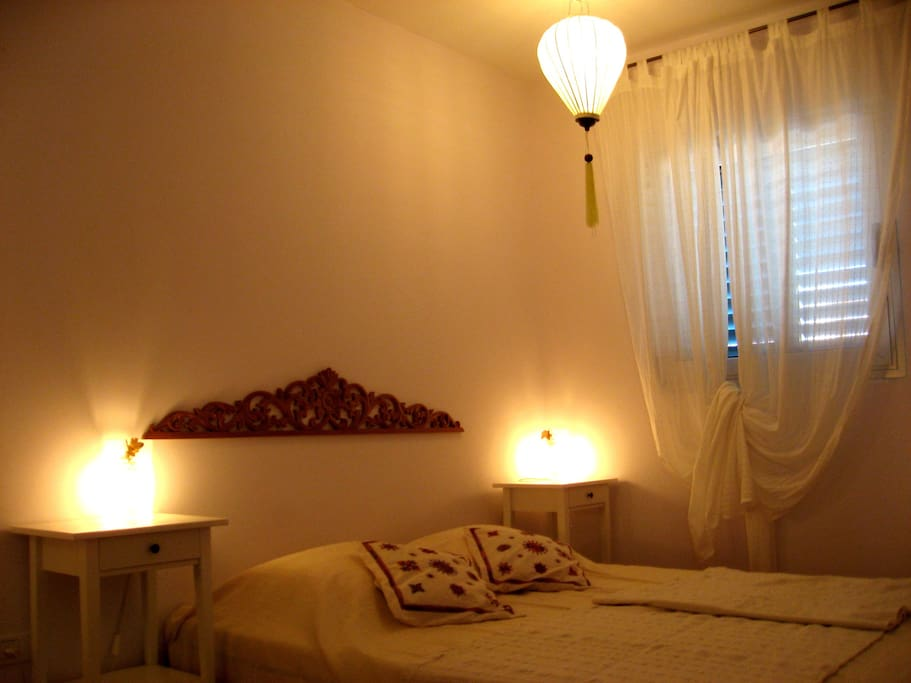 The bedroom with a queen size double bed