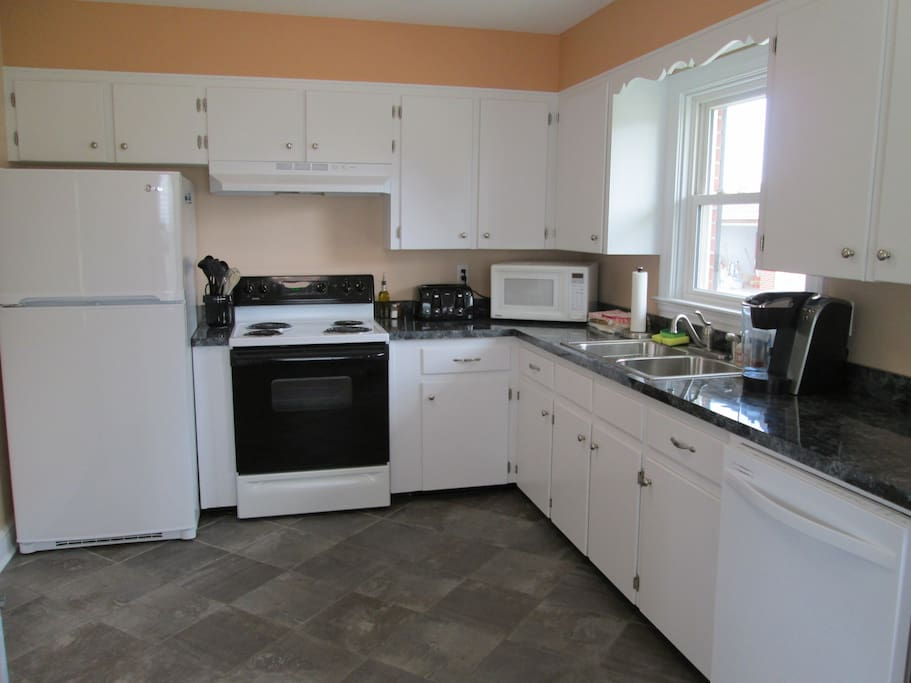 Kitchen with toaster, microwave, Keurig coffee maker, and dishwasher.