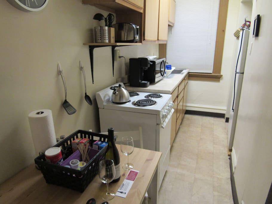 Fully-equipped kitchen w/full size refrigerator and Keurig machine.