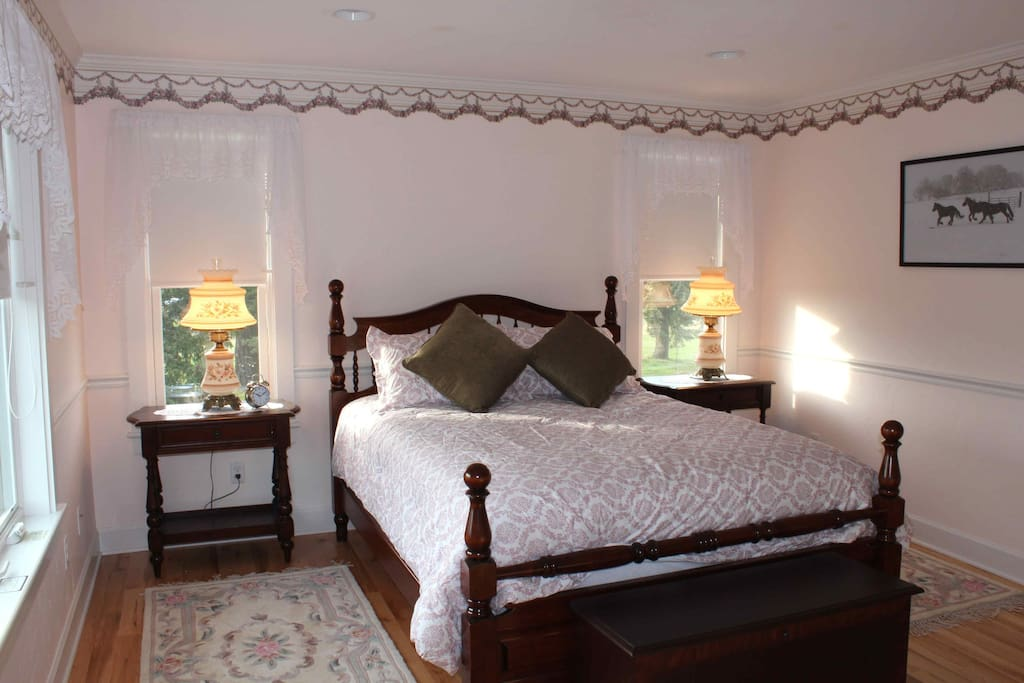 Meadowbrook room: Cherry spindle bed, hardwood floors, wool rugs, hurricane lamps