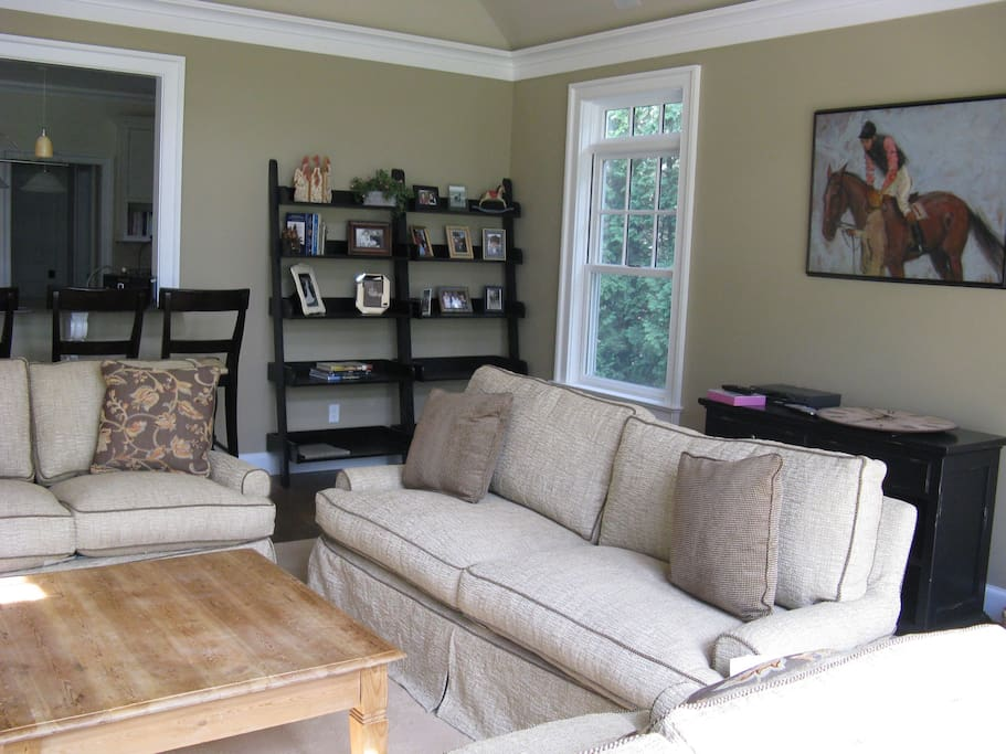 Living room with fireplace (not shown), beautiful sunset views and  of private horse farm.