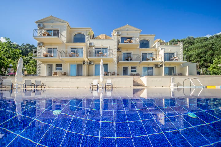 Enjoy your stay in the ground floor spacious luxury studio apartment overlooking the private pool.
